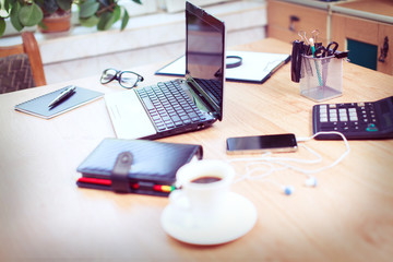 Office workplace with laptop and smart phone on wood table