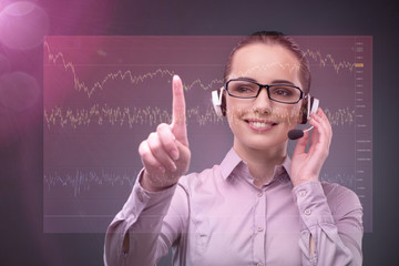 Businesswoman with many financial charts