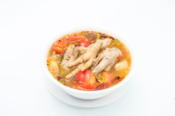 Chicken feet in a bowl with spicy soup