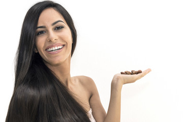 Argan oil. Natural treatment for skin and hair. The woman has in hand argan nuts , where the precious oil is obtained.