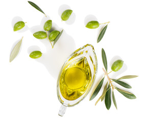 Olive oil and olive branch, above view.
