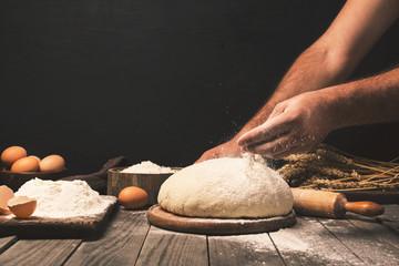 Wall Mural - Men hands sprinkle dough flour close up