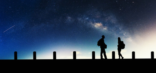 Galactic beautiful landscapes, travelers on the path that the Milky Way galaxy and the background light of the stars across the night sky.