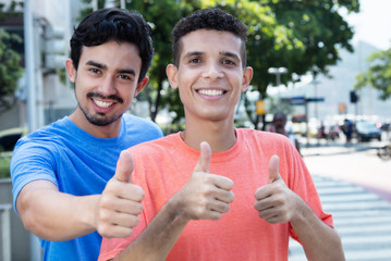 Latin man with mexican friend showing thumbs