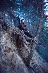 black angel in the forest