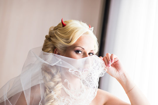 Bride with horns of the devil for Halloween