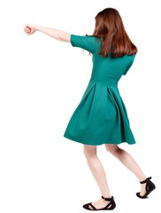 skinny woman funny fights waving his arms and legs. brunette in a green short dress causes a sharp blow.