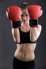 Woman boxer in red gloves