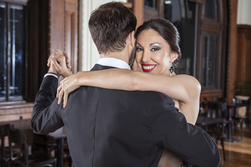 Woman Performing Tango With Man In Restaurant