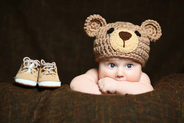 cute thoughtful baby with a knitted hat