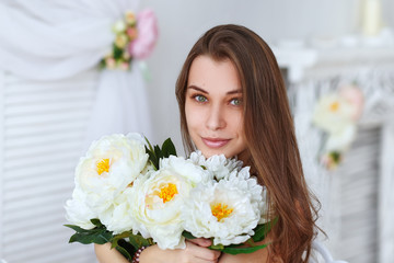 Beautiful girl with a bouquet flowers
