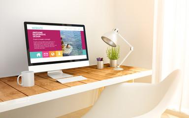 minimalist workplace with fresh design website on computer