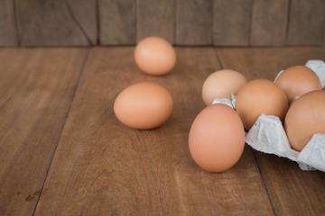 Fresh rural eggs on a wooden board