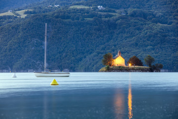 morning twilight on the lake with church and yacht