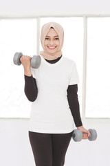 asian sporty woman lifting weight using dumbbells