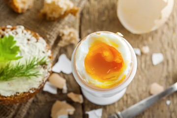 Perfect soft boiled egg with bread and butter for breakfast. Traditional healthy food. Top view.