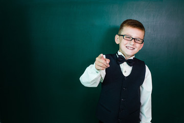 Happy schoolboy with glasses