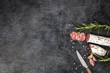 Salami on dark background