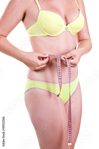 Beautiful young girl in a swimsuit measure yourself body fragmen