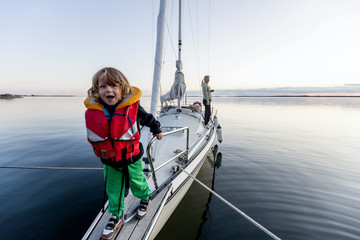 Happy boy on sailing boat