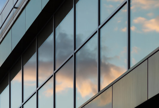 Sky reflected in a glass facade