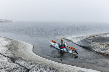 Woman canoeing, Sweden