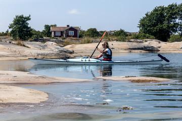Woman kayaking, Sweden