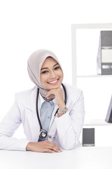 asian female doctor with stethoscope sitting and smiling
