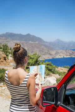 Woman reading map, Greece
