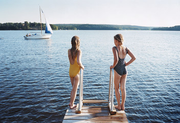Two girls on a bridge.