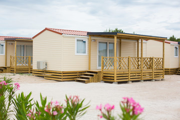 yellow wooden guest house at the beach