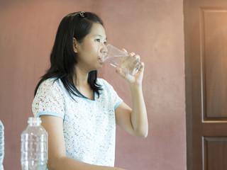 Waman drinking water.