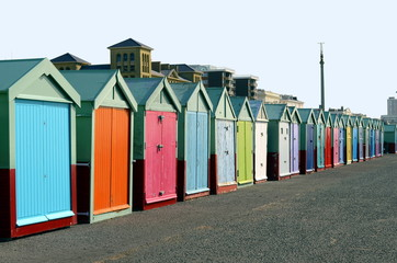 Colorful row of bathing boxes on the quay of Brighton Beach, UK