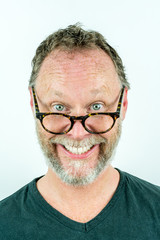 Happy man with beard and glasses laughing, funny portrait. Casual clothing.