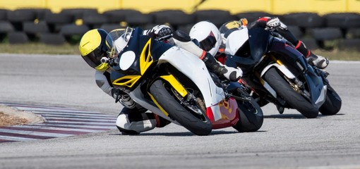 Mototbikes Racing on Track
