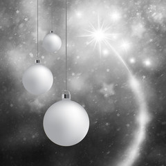 Lovely silver Christmas bulbs set on abstract blurred silver color background with fireworks. Lovely Happy New Year and Christmas holiday greeting card background.