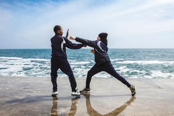 Children training karate on the stone coast