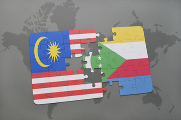 puzzle with the national flag of malaysia and comoros on a world map background.