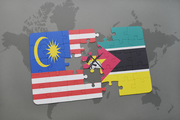 puzzle with the national flag of malaysia and mozambique on a world map background.
