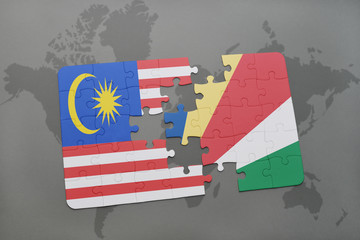 puzzle with the national flag of malaysia and seychelles on a world map background.