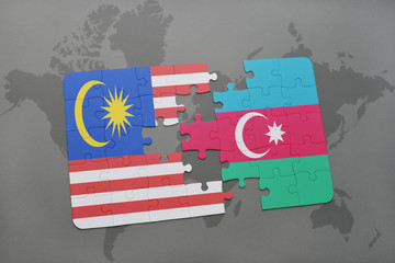 puzzle with the national flag of malaysia and azerbaijan on a world map background.