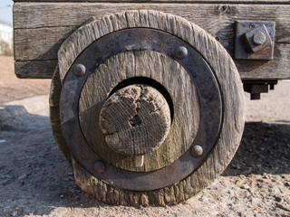 Close up of an old wooden wheel with an iron rim that suited in the hub of the wooden carts