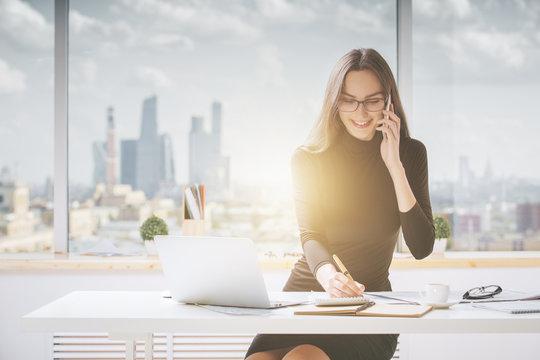 Friendly businesswoman working in office