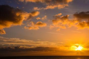 Foto op Plexiglas Zee zonsondergang Colored Clouds at Sunset