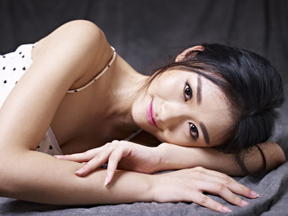 young asian woman lying on floor