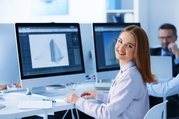 Young female engineer working in the office