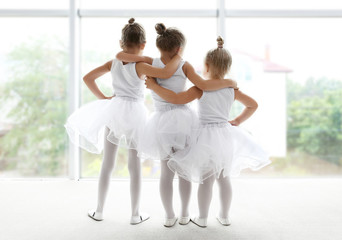 Cute girls looking out window in ballet class