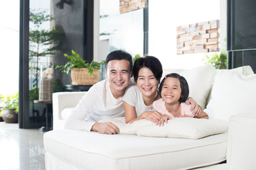 Young Asian Family at Home