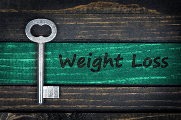 Weight Loss word and old key