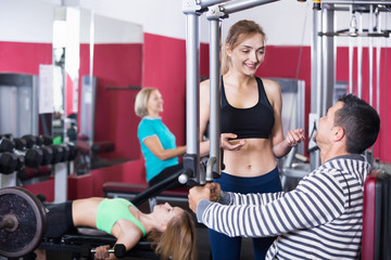 Active positive people  weightlifting training in health club